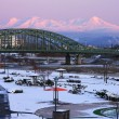冬・夕暮れの旭橋と大雪連峰